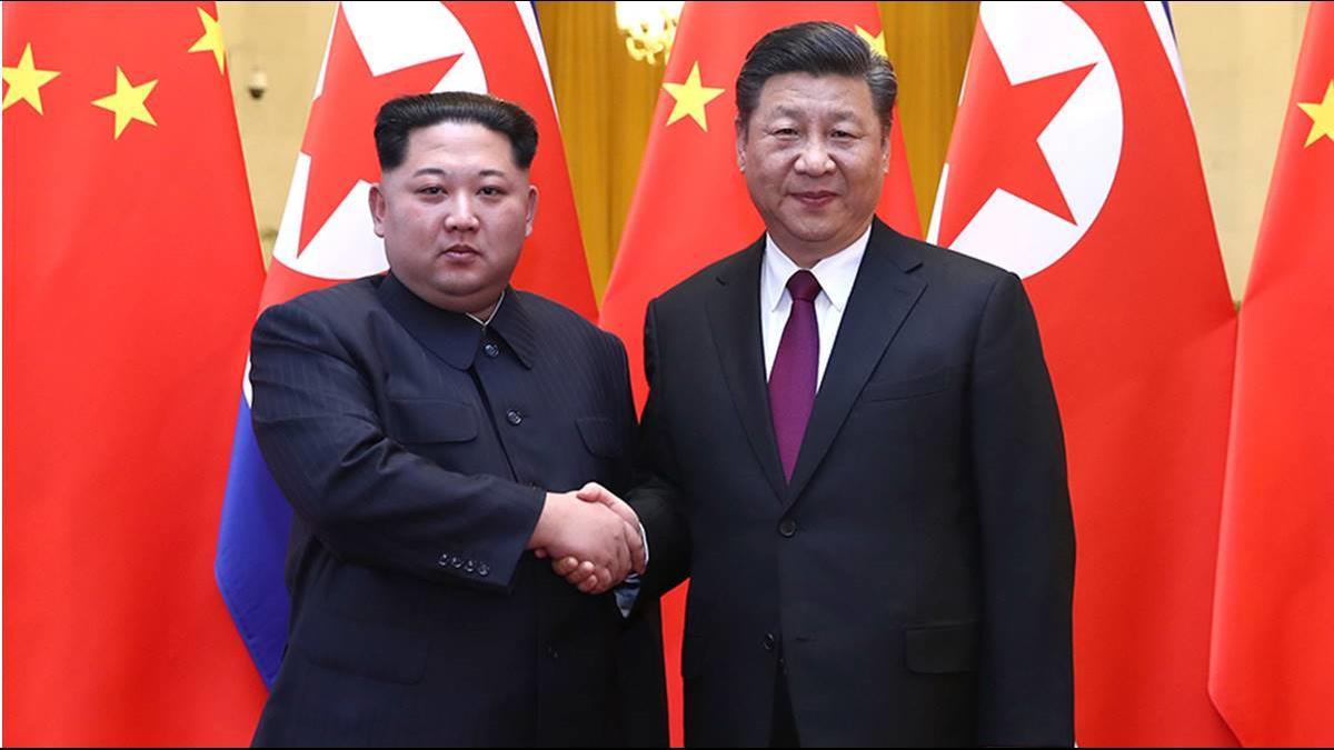 北京官媒證實習近平邀金正恩訪中 公布握手照