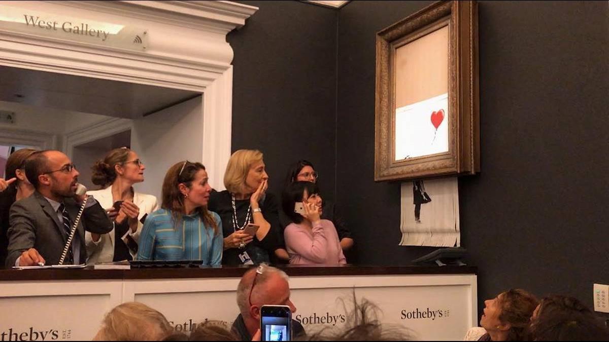 【影片】4200萬畫作在拍賣會上「自毀」專家:絞碎畫可能繼續增值