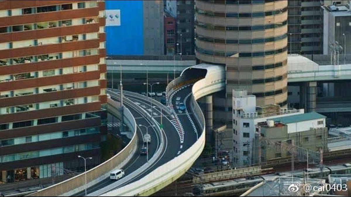 最牛釘子戶!日本這大樓竟遭阪神高速公路剖肚穿過